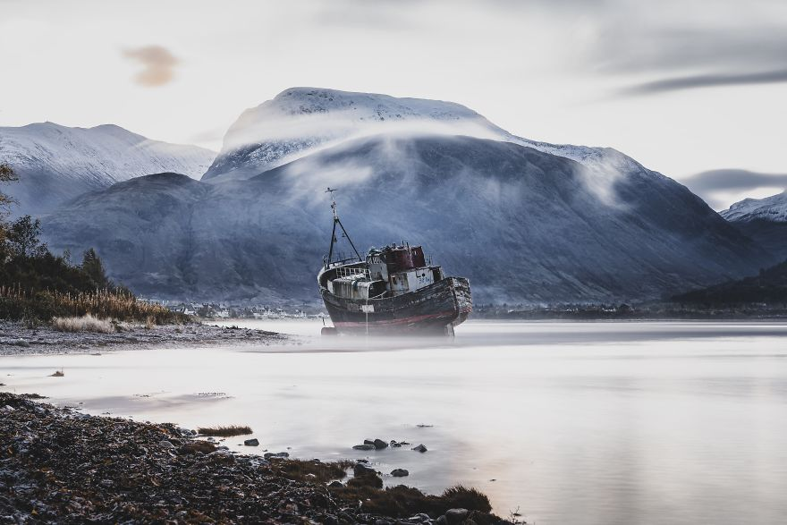 Abandoned Boat With The Backdrop Of The Highest Mountain In The UK