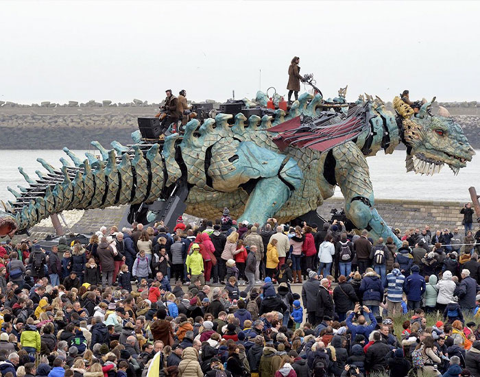 The Citizens Of Calais Witnessed A 25-Meter-Long Fire-Breathing Mechanical Dragon Manned By 17 People