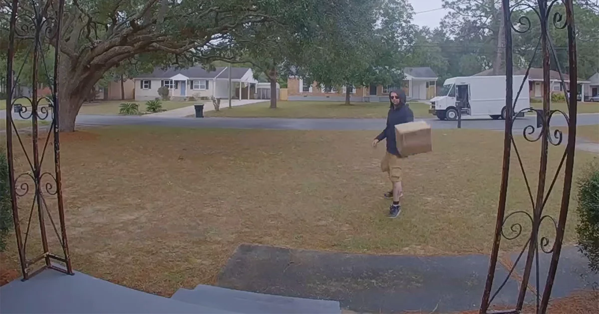 FedEx Guy Caught On Camera Throwing An Expensive Package Rather Than Walking A Couple Of Steps