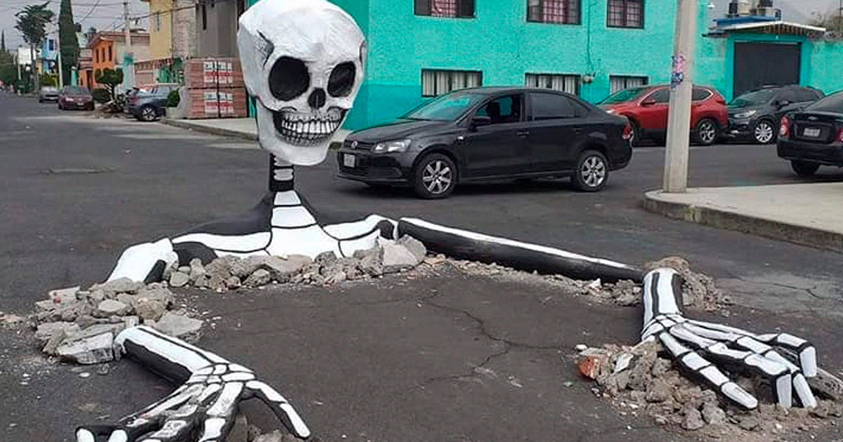 Giant Skeletons Emerge From A Street In Mexico City