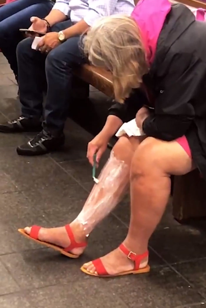 Doing Some Shaving In A Train Station