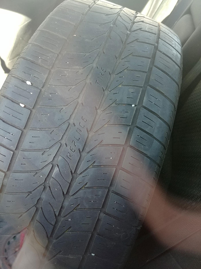 """This Tire Reads """"Replace Tire"""" When It Gets Worn Down"""