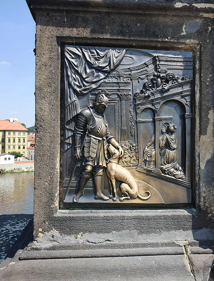 The Way That The Statue Has Been Worn By People Stroking The Dog On The Charles Bridge