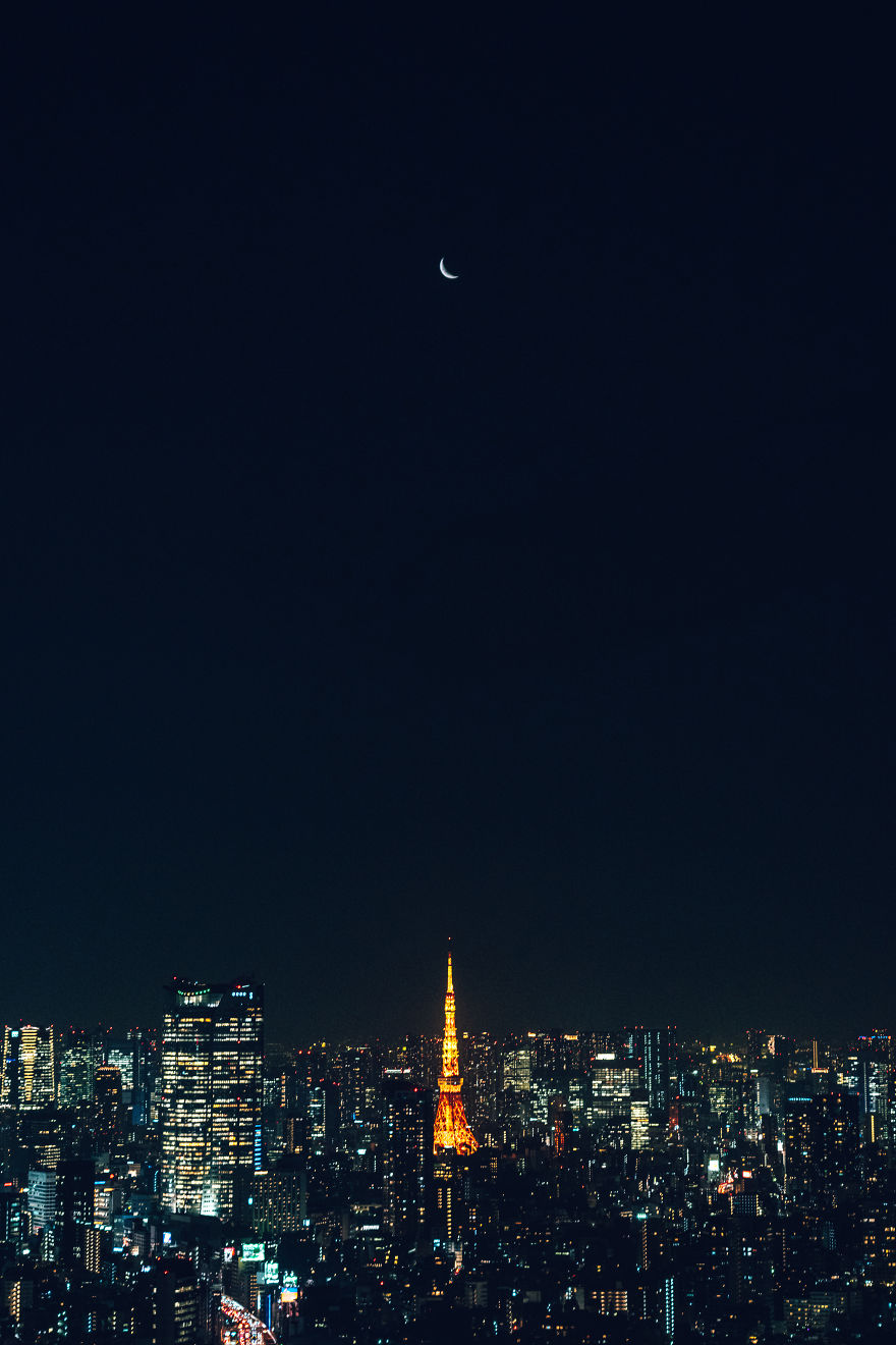 Tokyo Tower And The Crescent Moon Reflected In The Glass