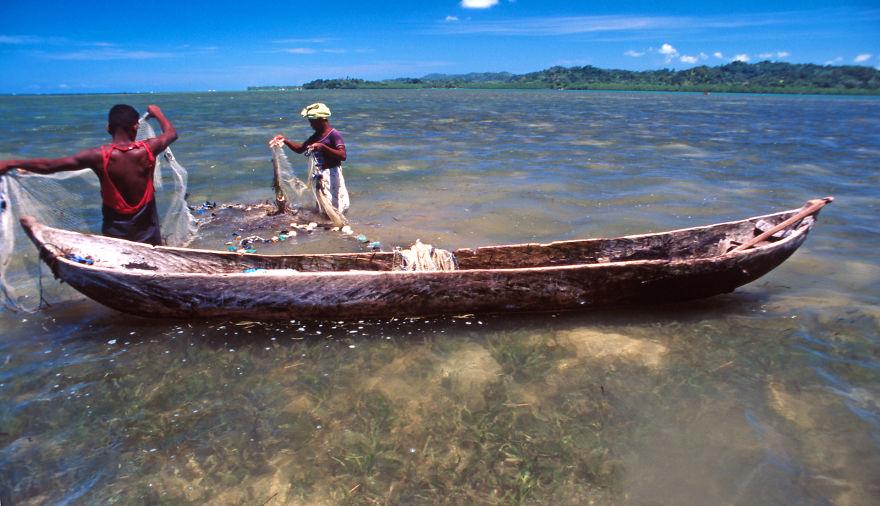 Fishermen In A Lagoon