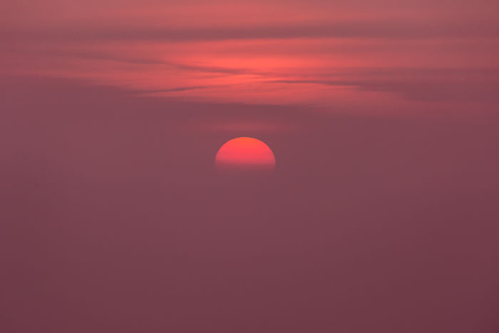 Sun Sets In The Mist