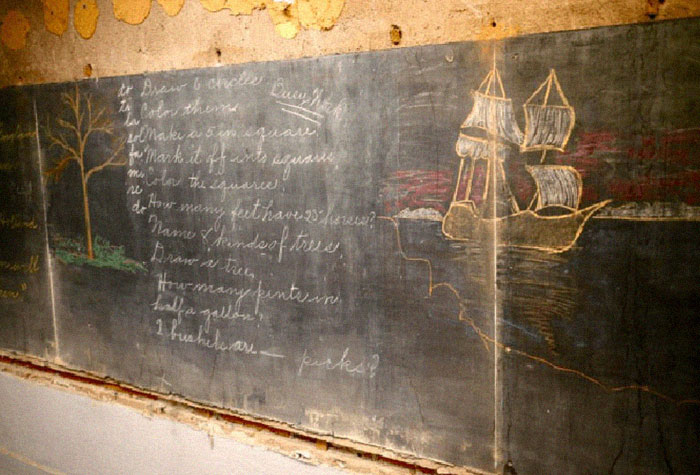 Construction Crew Goes To Renovate A School In Oklahoma City, Discovers Chalkboards Frozen In Time For Over 100 Years