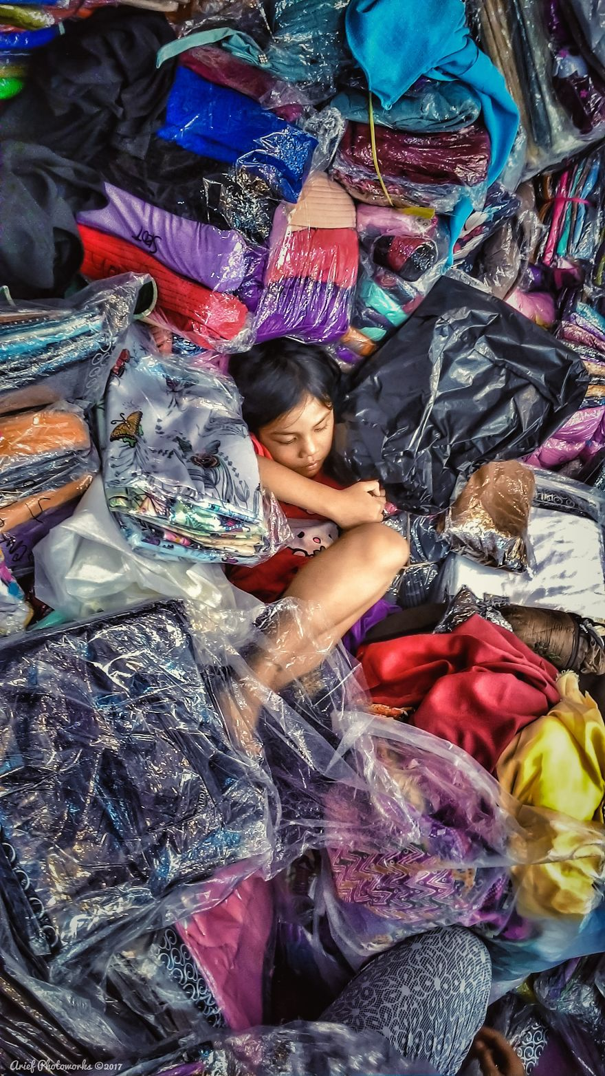 Child Playing In Her Parents' Merchandise