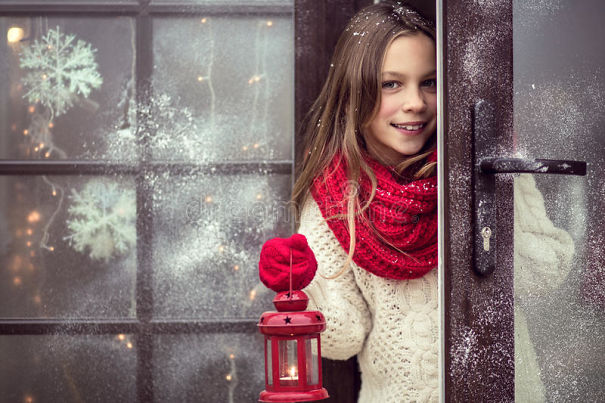 christmas-child-girl-welcome-guests-holding-holiday-lantern-snow-weather-house-decorated-47523487.jpg
