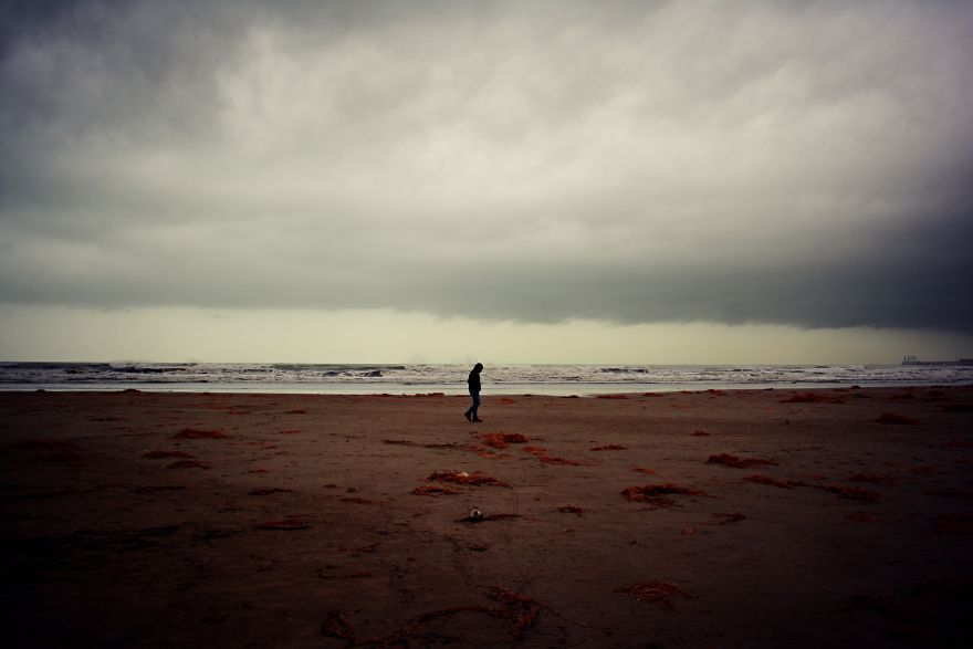 A Lonely Figure Wanders The Beach