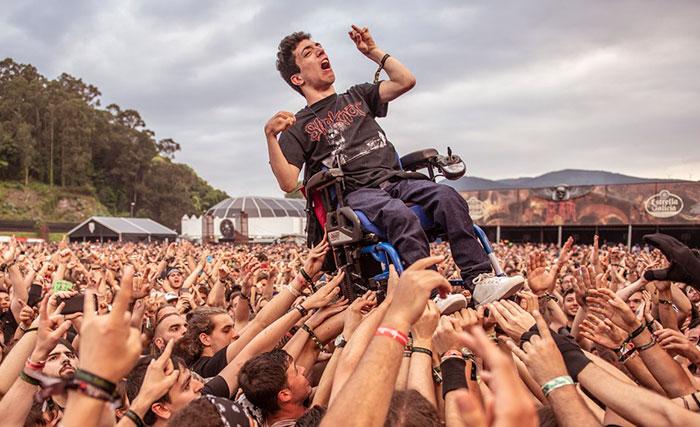 This Fan In Wheelchair Carried In A Rock Festival
