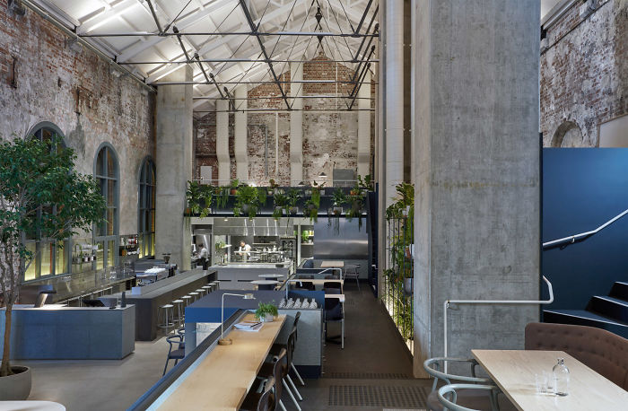 Former Power Station Converted Into An Industrial Cafe And Restaurant With Exposed Brickwork And Abundant Planting In Melbourne, Australia