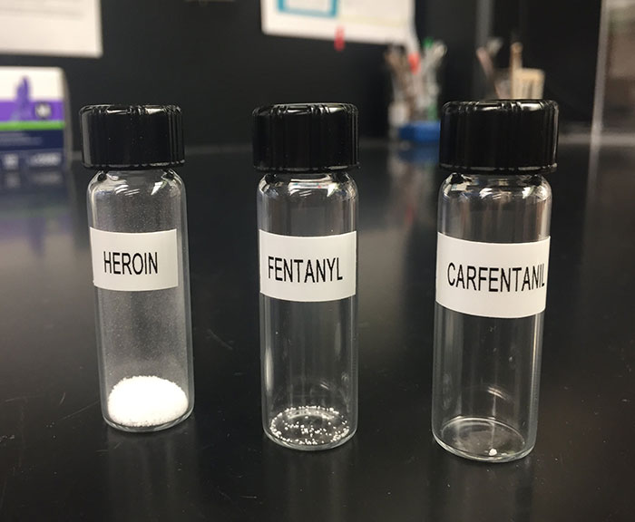 Vials Of Heroin, Fentanyl, And Carfentanil Side By Side, Each Containing A Lethal Dose Of The Drug