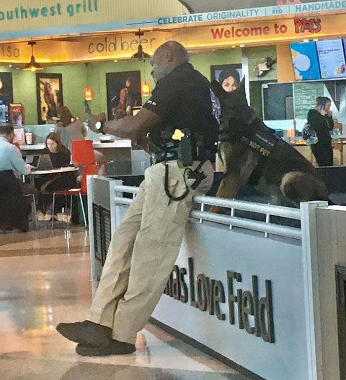 Image result for woman takes photo of officers with his dog