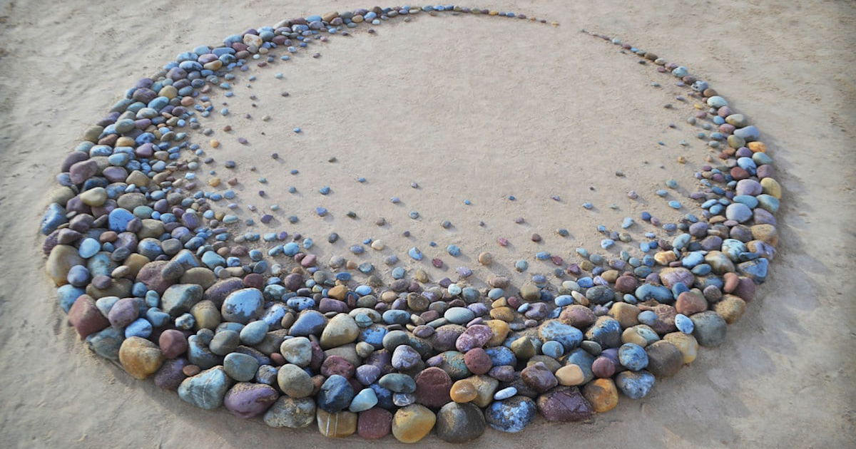 Artist Surprises Beach Goers By Arranging Stones Into Mesmerizing Patterns Along The Coast