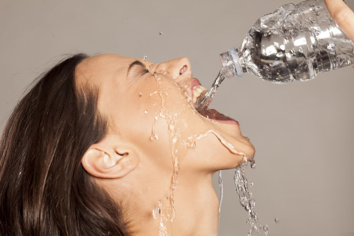 Women-Dont-Know-How-To-Drink-Water-Stock-Photos