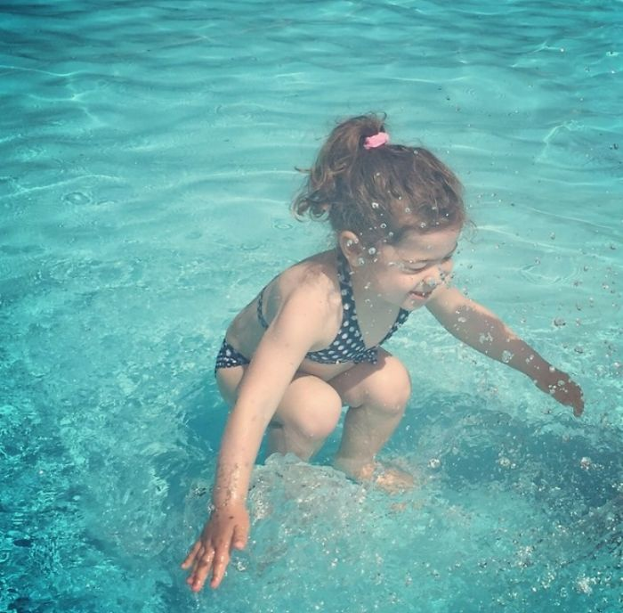 This Girl Looks Like She's Underwater And Jumping Into Water At The Same Time