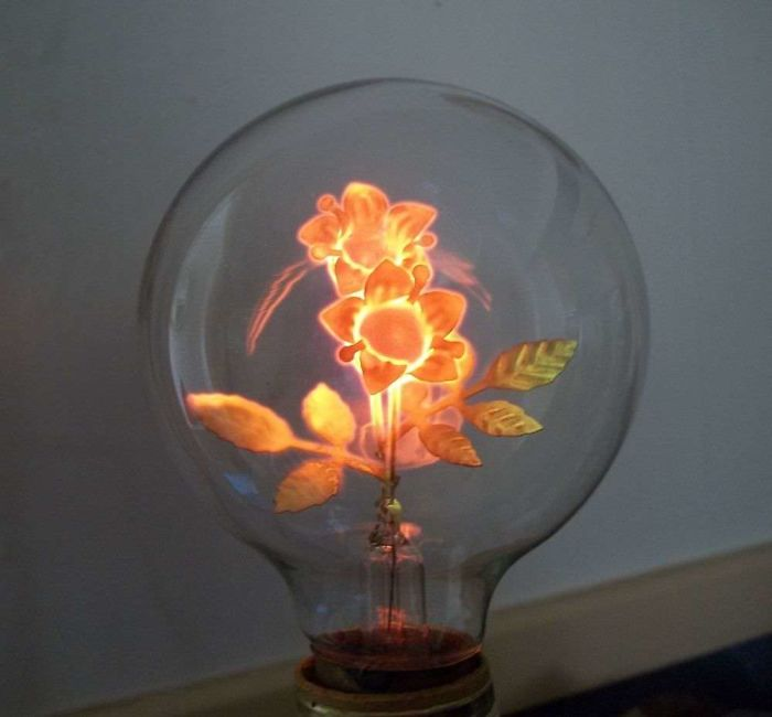 The Filament Of This Antique Light Bulb Is Shaped Like Flowers
