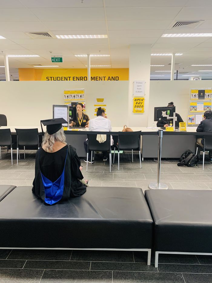 Girlfriend's Grad Cancelled Due To The Virus So She's Picking Up Her Degree From The Student Desk