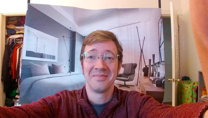 Guy Working From Home Fools His Coworkers Into Thinking He Lives In A Luxury Apartment