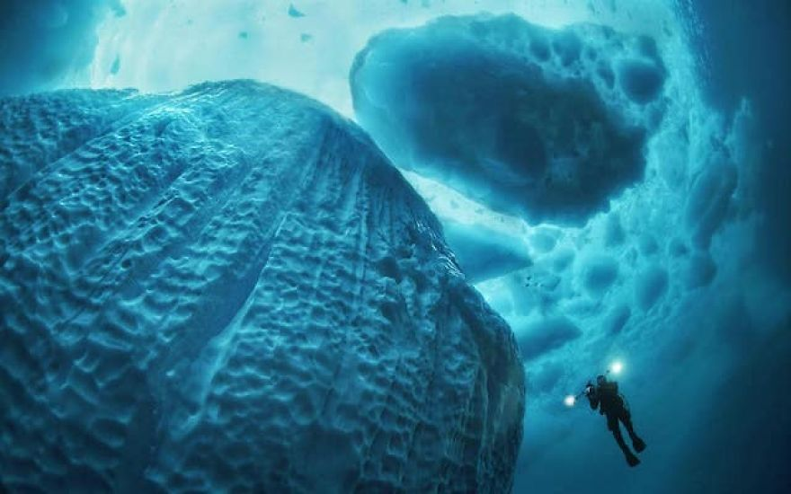 Photographer Takes Incredible Pictures Of Greenland's Underwater Icebergs