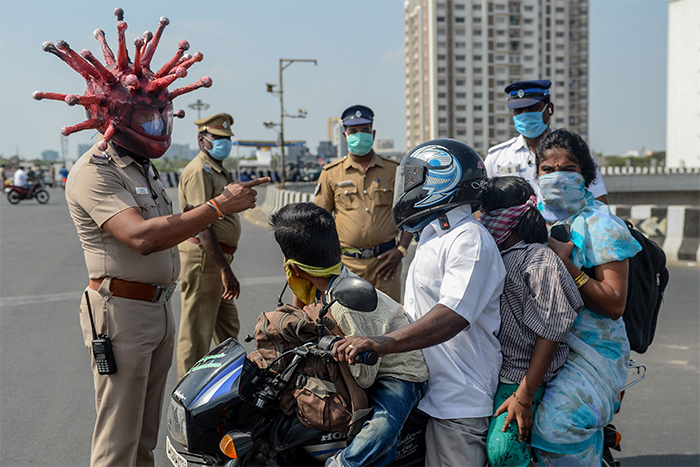 Policeman In India Creates A Coronavirus Helmet To Frighten People Who Refuse To Stay At Home