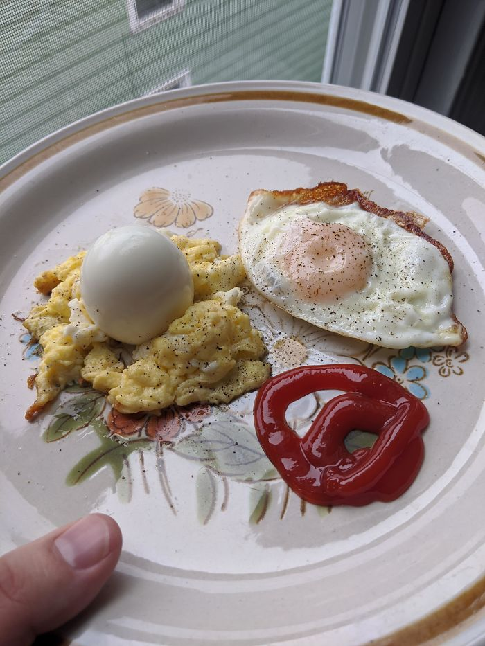 Hard Boiled Egg On A Bed Of Scrambled Egg With A Sunny Side Of Egg