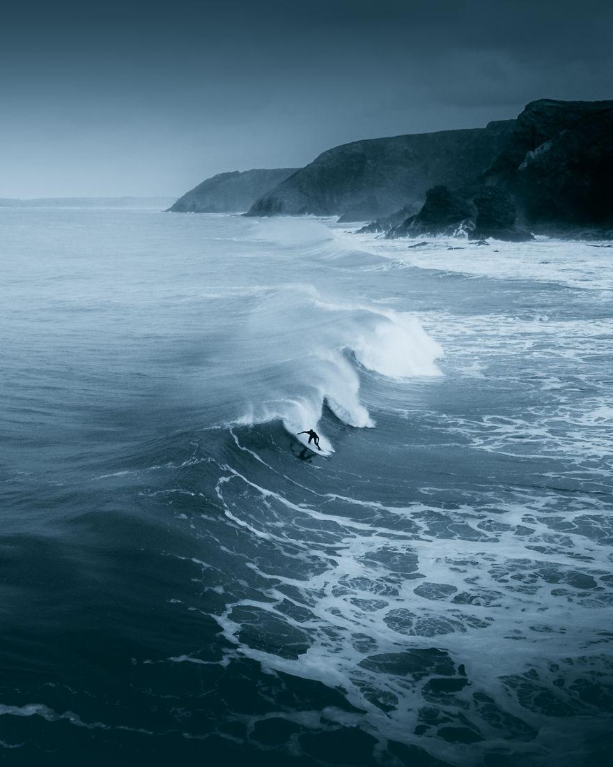 A Lone Surfer Braving The Winter Cold On The Cornish North Coast
