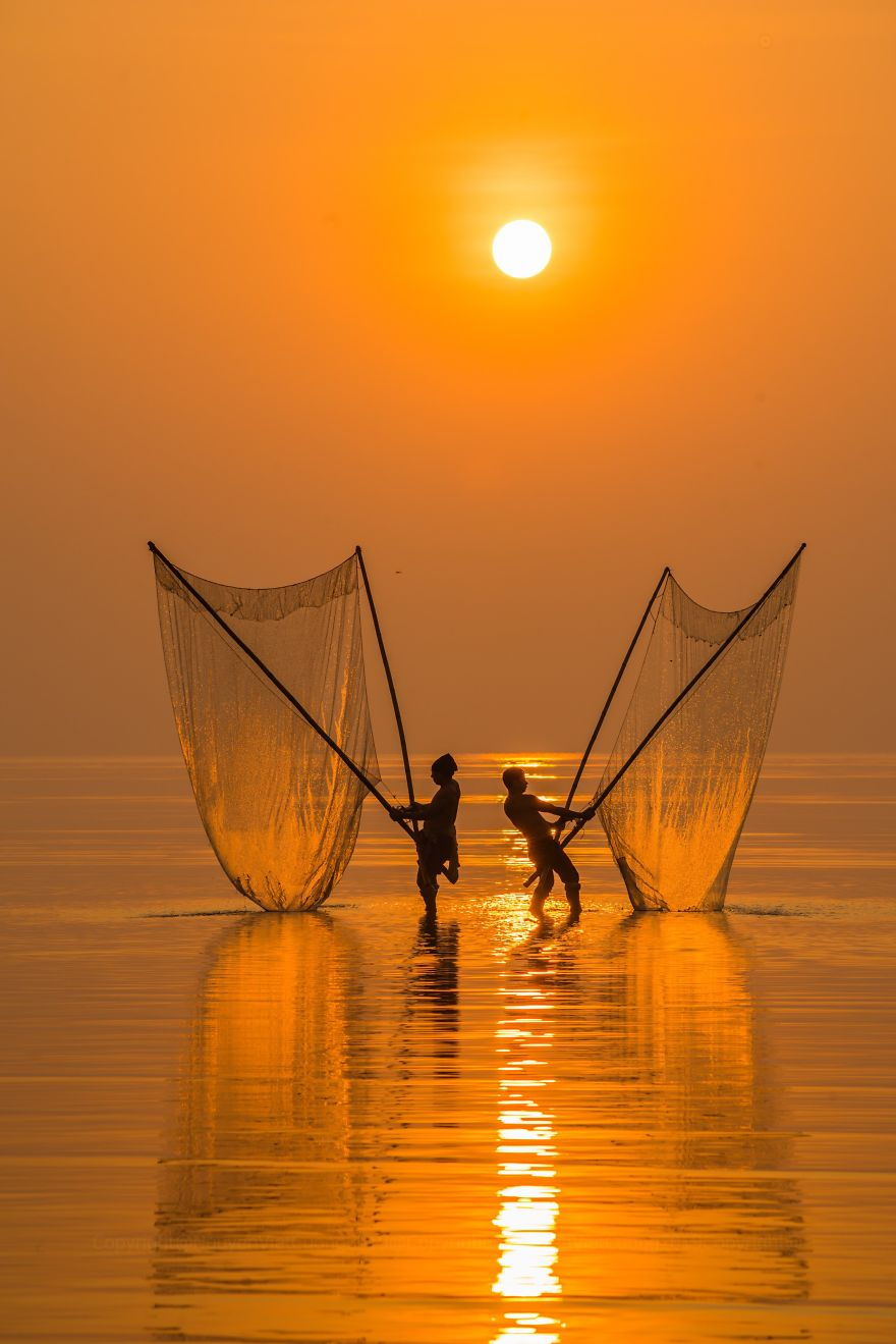 Fisherman Under The Dawn