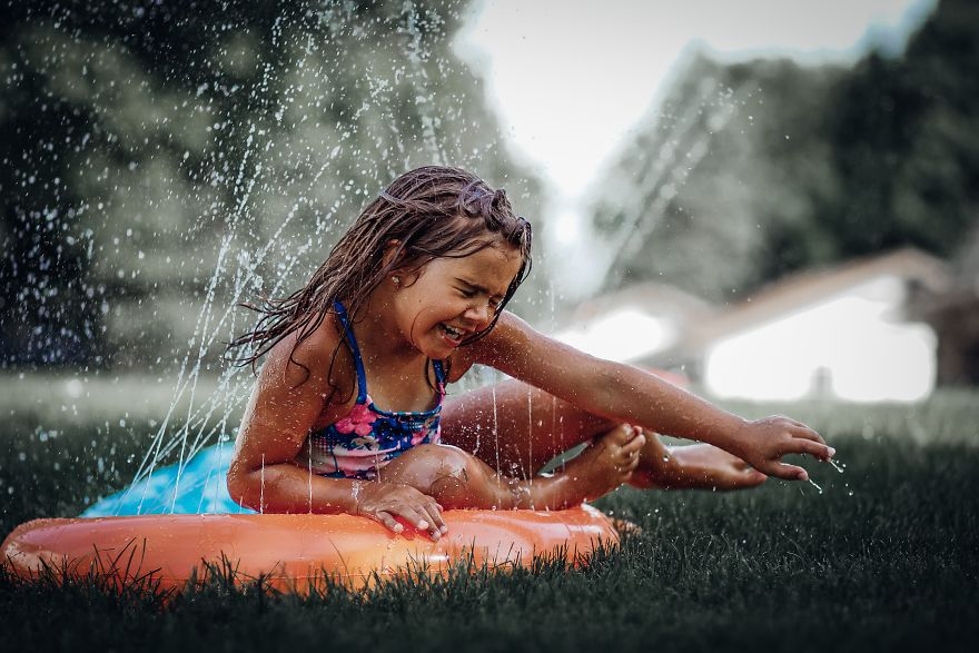 Having Fun On A Summers Day On The Slip And Slide