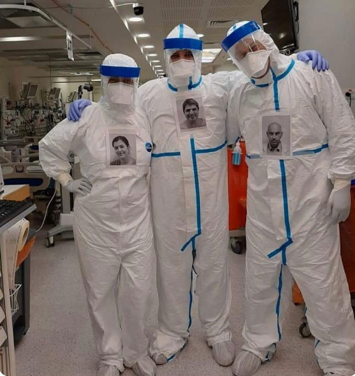 US Doctors Paste Photos Of Them Smiling On Their Protective Suits To Reassure COVID-19 Patients