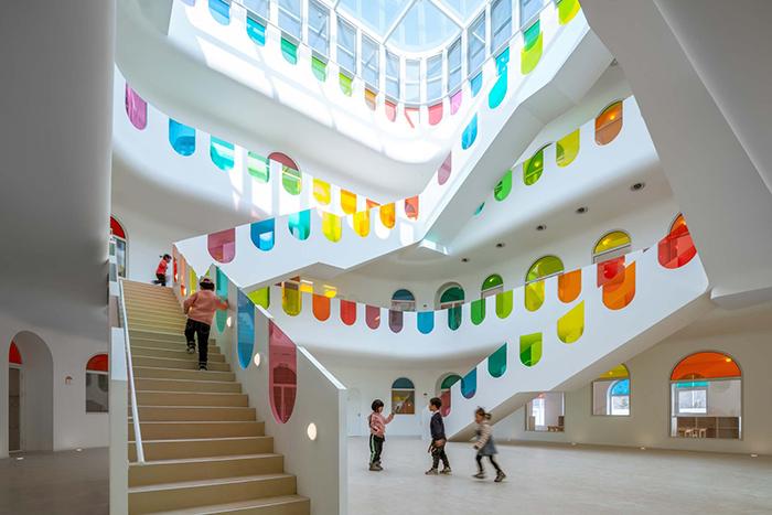 Kindergarten Designed As Kinder-Garden With A Kaleidoscope And Rainbow Colors
