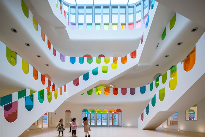 Kindergarten Designed As Kinder-Garden With A Kaleidoscope And Rainbow Colors