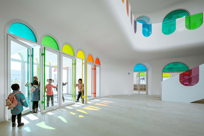 483 Rainbow-Colored Glass Panels Emit A Rotating Kaleidoscope In This Playful Kindergarten
