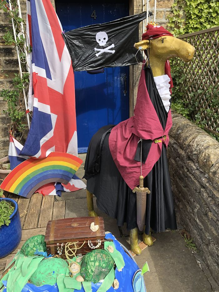 Gloria The Giraffe Dressed Up As A Pirate With Her Treasure Trove