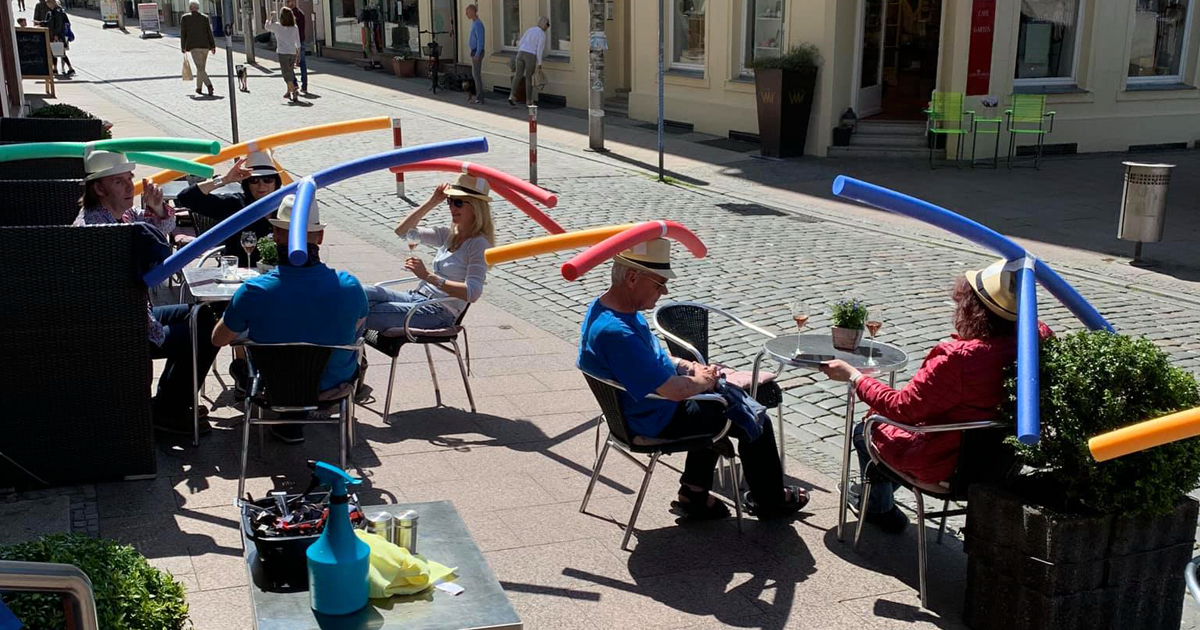 A Cafe In Germany Reopened And Celebrated It By Giving Patrons Hats With Pool Noodles