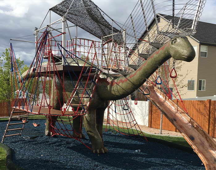 This Dad Should Win An Award For Building An Incredible 14-Meter Dinosaur Jungle Gym For His Kids