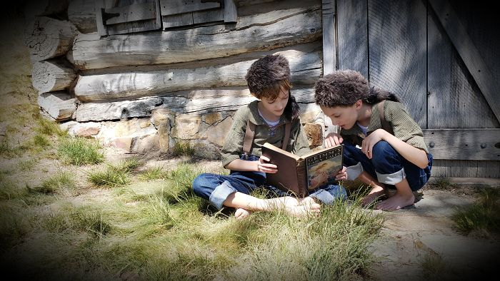 My Twins Missed Singing In The Pioneer Program At School Because Of Quarantine. But We Finished Their Costumes Anyway And Took Their Picture By A Reproduction Log Cabin Near Us. The Book Is My Grandmother's Copy Of Grimm's Fairy Tales From 1932