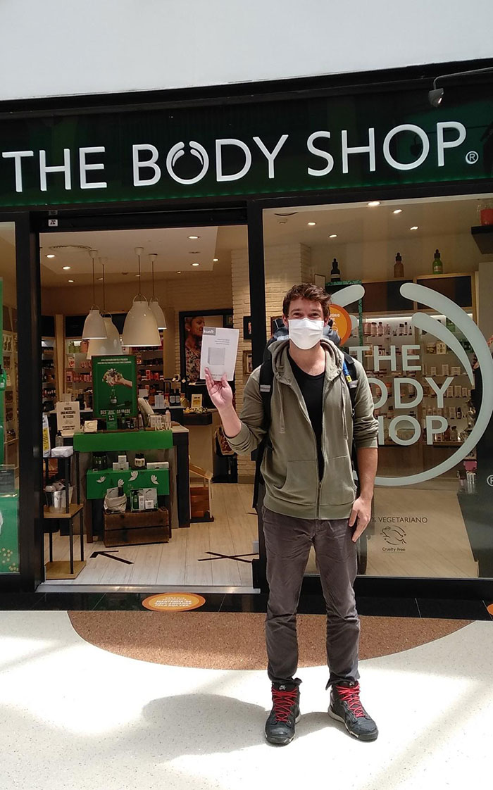 An Instruction Manual In Front Of The Body Shop