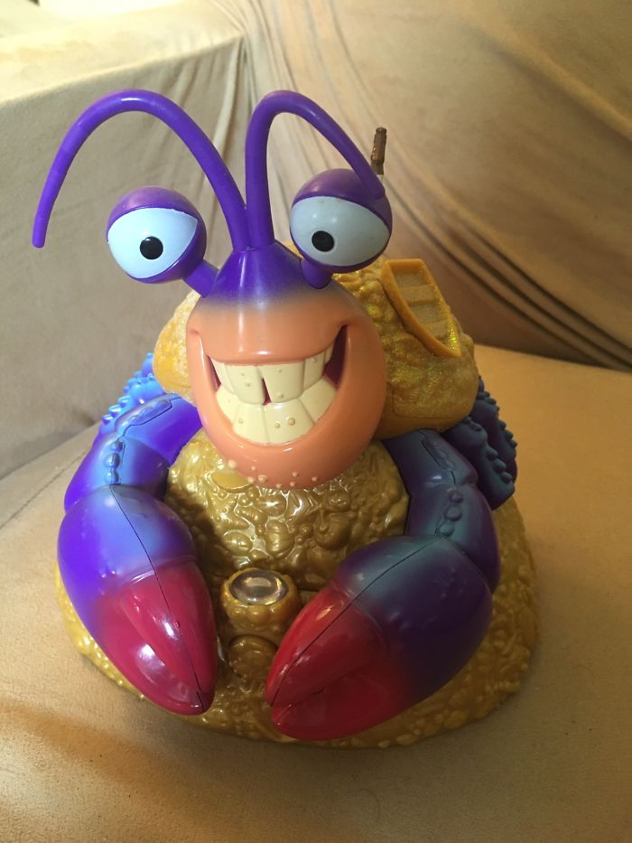 "This Is My Tamatoa Jewelry Box. The Button To Open It Is Between His Claws. The Thing On Top Of It Is A Ring. Yes, It Plays Part Of ""Shiny"""