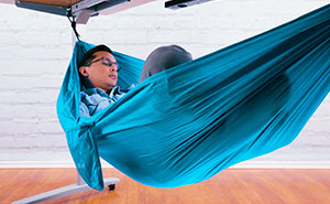 This $55 Under-Desk Hammock Lets Employees Take The Most Chill Breaks At Work