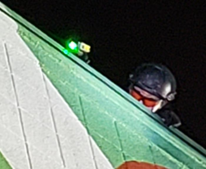 What Is This Scanner That A Rooftop Cop Had At A Protest? Seemed To Be Shining A Green Laser At Certain People In The Crowd