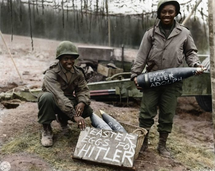 "Two American Soldiers Proudly Show Off Their Personalized ""Easter Eggs"" (155mm Artillery Shells) Before Firing Them"