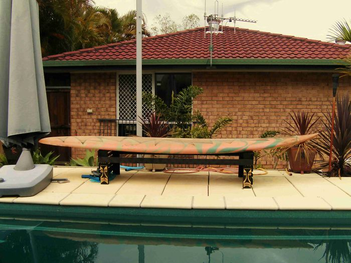 Tiki Themed Poolside Bench Made From Junkyard Sourced Windsurfer Board