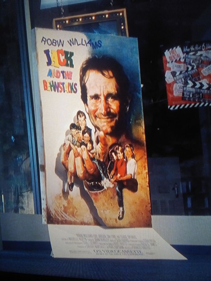 """In A Scene In """"The Lost World: Jurassic Park"""" There Are Fake Movie Posters Featuring Tom Hanks In Tsunami Sunrise, Robin Williams In Jack And The Behnstacks, And Arnold Schwarzenegger In King Lear"""