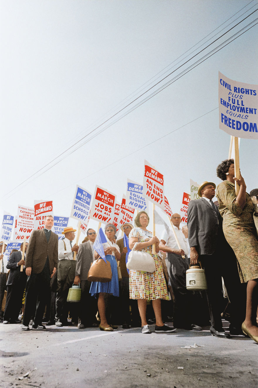 Demonstrators Marching In The Street Holding Signs During The March On Washington