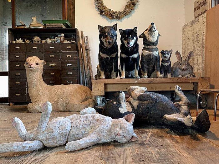 Cute Video Shows Dog Trying To Blend In Between Animal Sculptures