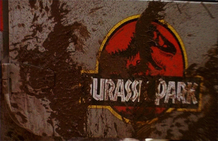 "At The End Of Jurassic Park When The Remaining Crew Is About To Get Into The Heilcopter, The JP Logo Is Covered With Mud To Read ""Your Ass Park"". Condemning The Park In A Hilariously Brilliant Move"