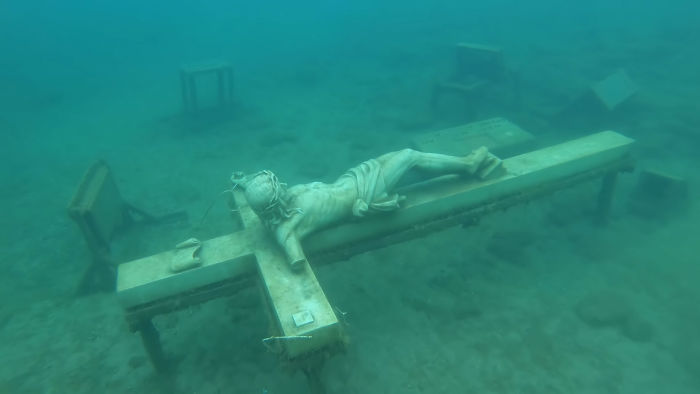 A Statue Of Jesus At The Bottom Of Lake Michigan