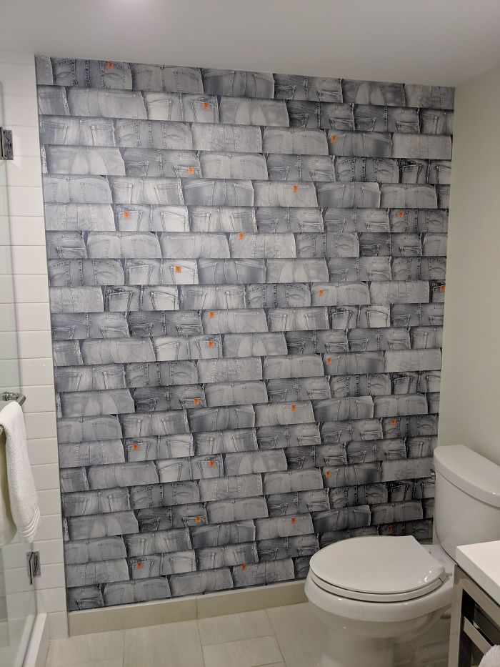 "This Hotel Bathroom ""Tile"" Wall Is Actually Just Numerous Pictures Of Denim-Clad Butts"